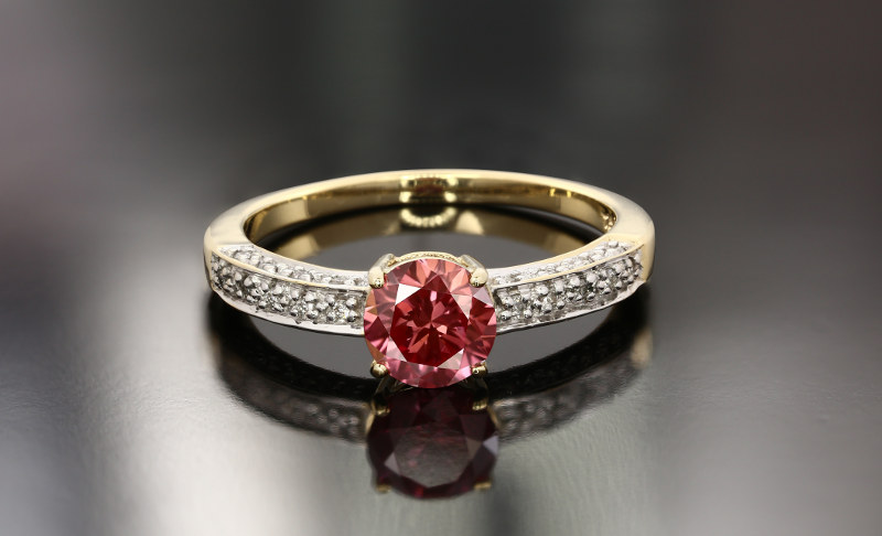 Gold ring with red diamond
